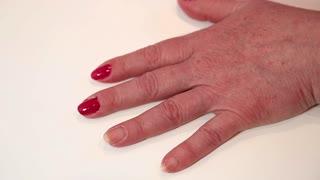 Manicure procedure in beauty salon. Woman doing nails in beauty salon. Manicure treatment in beauty salon