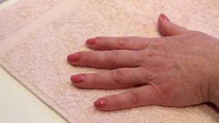 Manicure procedure in beauty salon. Woman removes varnish from nail. Manicure treatment in beauty salon