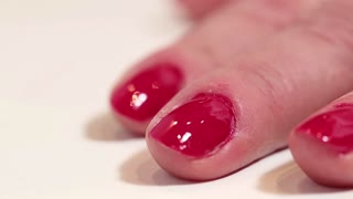 Manicure procedure with nail sciccors in beauty salon, pare finger-nails