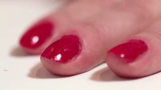Manicure procedure with nail scissors in beauty salon, pare fingernails
