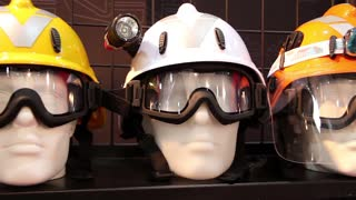 Mannequins with protective helmet and goggles