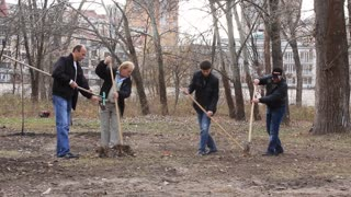 Manual labour. Cleaning in city park. People are busy handiwork