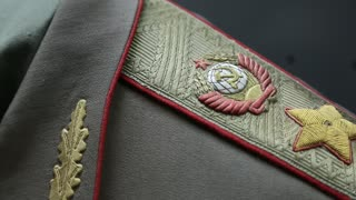 Marshals epaulet with coat of arms of the Soviet Union, higher military rank. Old military uniform of Soviet Union times. Military insignia with State Emblem of the USSR, hammer and sickle, gold star
