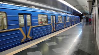 Metro station and blue train