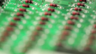 Microcircuit chip with electronic components. Close-up of micro circuit, resistors and chips. Chips and resistors on green circuit board close up. Close up of electronic circuit board, macro lens