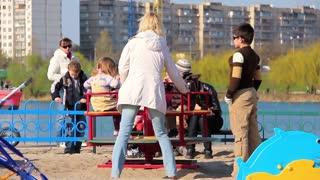 Mother and children on new childrens playground