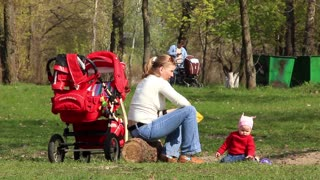 Mother with baby in city park