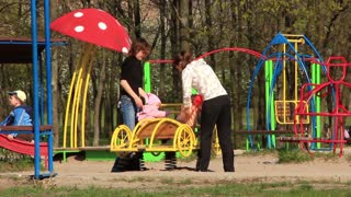Mothers with babies on childrens playground