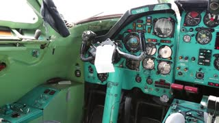 Old aircraft cabin. Inside educational training aircraft Tu-134UBL Combat Trainer. Aircraft instruments panel, interior of old airplane since the Soviet Union