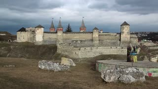 Old castle, stone fortress and monument to seven cultures at foreground, located in Kamianets-Podilskyi city in western Ukraine, historic region of Podolia. National historical-architectural sanctuary