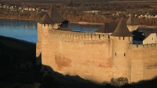 Old castle, stone fortress at sunset in Khotyn city, western Ukraine. Khotyn, first chronicled in 1001 year, is located on southwestern bank of Dniester River, is part of Bessarabia historical region