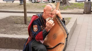 Old free Cossack. Bandura player. Bandura - Ukrainian string instrument