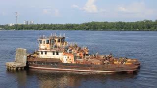 Old river tugboat on Dnieper river in Kiev, Ukraine