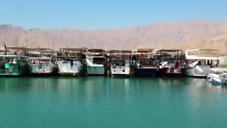 OMAN, MUSANDAM PENINSULA, GULF OF OMAN, FEBRUARY 2, 2016: Dibba Al-Baya harbour, Sultanate of Oman. Oman - arab country in southeastern coast of the Arabian Peninsula. Musandam - governorate of Oman