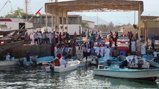 OMAN, MUSANDAM PENINSULA, GULF OF OMAN, FEBRUARY 2, 2016: People at fish market in Dibba Al-Baya harbor, Sultanate of Oman. Oman - arab country in southeastern coast of the Arabian Peninsula