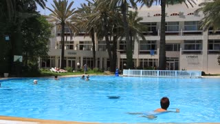 Open-air swimming pool in hotel area, Sousse, Tunisia