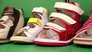 Orthopedic footwear on green background