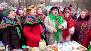 Pancake festival. Ukrainian folk song. Woman in Ukrainian traditional costume. Pancake week (week before Lent seven weeks before Easter). Sunday of the Apokreos Sexagesima.