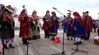 Pancake festival. Ukrainian folk song. Woman in Ukrainian traditional costume. Pancake week (week before Lent seven weeks before Easter). Sunday of the Apokreos Sexagesima.