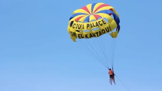 Parasailing, also known as parascending, or parakiting is a recreational kiting activity where a person is towed behind a vehicle while attached to a specially designed canopy wing that reminds one of a parachute, known as a parasail wing
