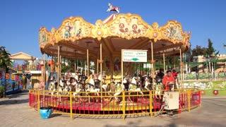 Park amusements. Children on merry-go-round