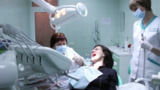 Patient and dentist in dental surgery