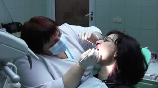 Patient and dentist in stomatological clinic