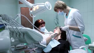 Patient and stomatologist in dental surgery