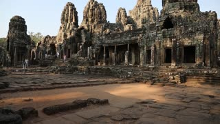 People at Bayon - Khmer temple complex at Angkor Thom, Siem Reap, Cambodia.