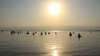 People bathe in Dead Sea in the morning, Israel