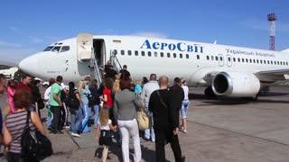 People boarding airplane