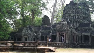 People in Angkor Thom temple complex near Siem Reap city in Cambodia