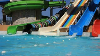 People in big recreation area with aquapark