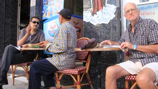 People in cafe on the street in Sousse, Tunisia