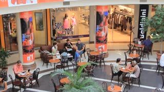 People in coffee house in shopping area