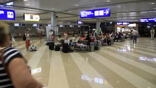 People in international airport Borispol. Waiting space in new terminal F