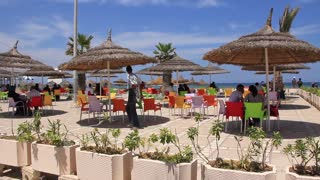People in summer cafe in Sousse, Tunisia