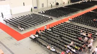 People inside big presentation hall