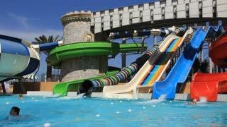 People inside big recreation area with aquapark