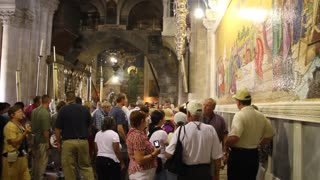 People inside Church of the Holy Sepulchre in Jerusalem, Israel