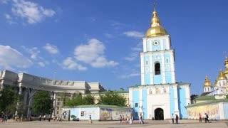 People near Mikhailovsky Golden-Domed Monastery on Mikhailovskaya square in Kiev, Ukraine