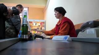 People on cash desk inside supermarket