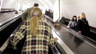 People on escalator