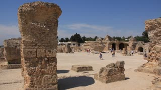 People on ruins of ancient Carthage in Tunisia. Carthage is a major urban centre that has existed for nearly 3,000 years on the Gulf of Tunis, developing from a Phoenician colony of the first millennium BC.