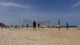People play volley-ball on a beach in Sousse, Tunisia
