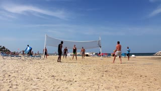 People play volley-ball on a beach