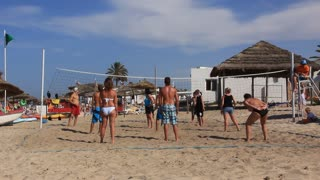 People play volley-ball on the beach in Sousse, Tunisia