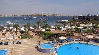 People swim in blue pool in hotel in Sharm El Sheikh, Egypt