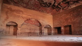 Petra - ancient historical and archaeological rock-cut city in Hashemite Kingdom of Jordan. Interior chamber of Urn Tomb of the Royal Tombs with niches carved out when it was converted into a church