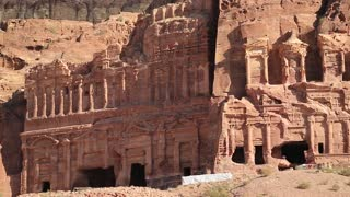 Petra - ancient historical and archaeological rock-cut city in Hashemite Kingdom of Jordan. Panorama view of Royal Tombs, from left to the right - Palace Tomb and Corinthian Tomb